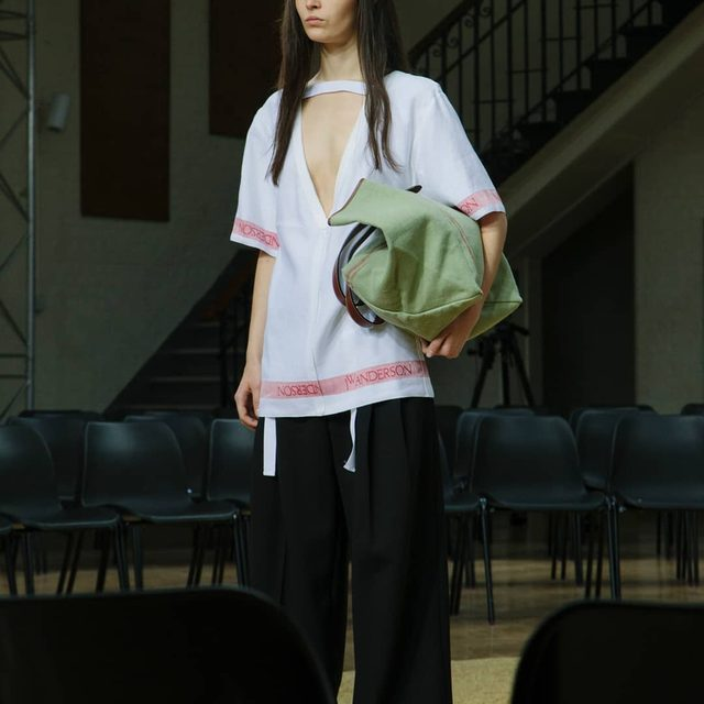 TEA TOWEL DEEP V DESIGN  WIDE LEG TROUSER WITH EXPOSED  SEAM DETAIL WILLOW JW ANDERSON BELT TOTE SPRING SUMMER 2018 BACKSTAGE  PHOTOGRAPH @daisywalker LINK IN BIO  AVAILABLE ONLINE AND IN JW ANDERSON WORKSHOPS  #JWASS18 #JWANDERSON #JWANDERSONWORKSHOPS